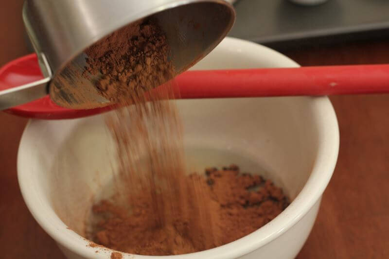 mix coconut oil with coco powder and stir